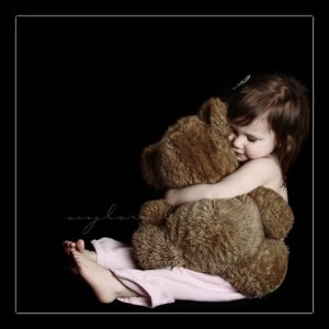 girl-hugs-bear
